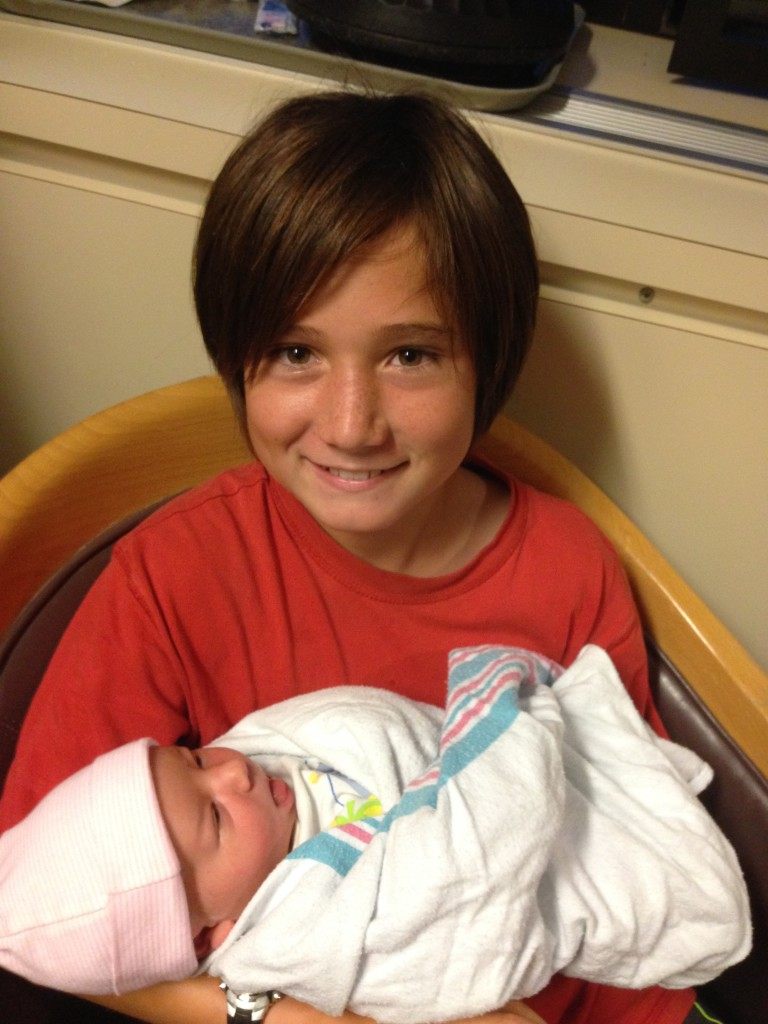J holding his new cousin.