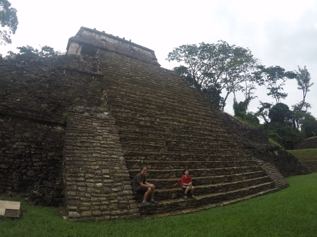 Coconut and J take a break from complaining to rest on the ruins at Palenque, Mexico.