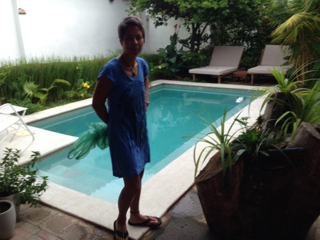 R poses in front of the small pool at our hotel in Granada. There were basil plants growing behind the lounge chairs and we cut a few leaves to have with tomatoes we got in the market.