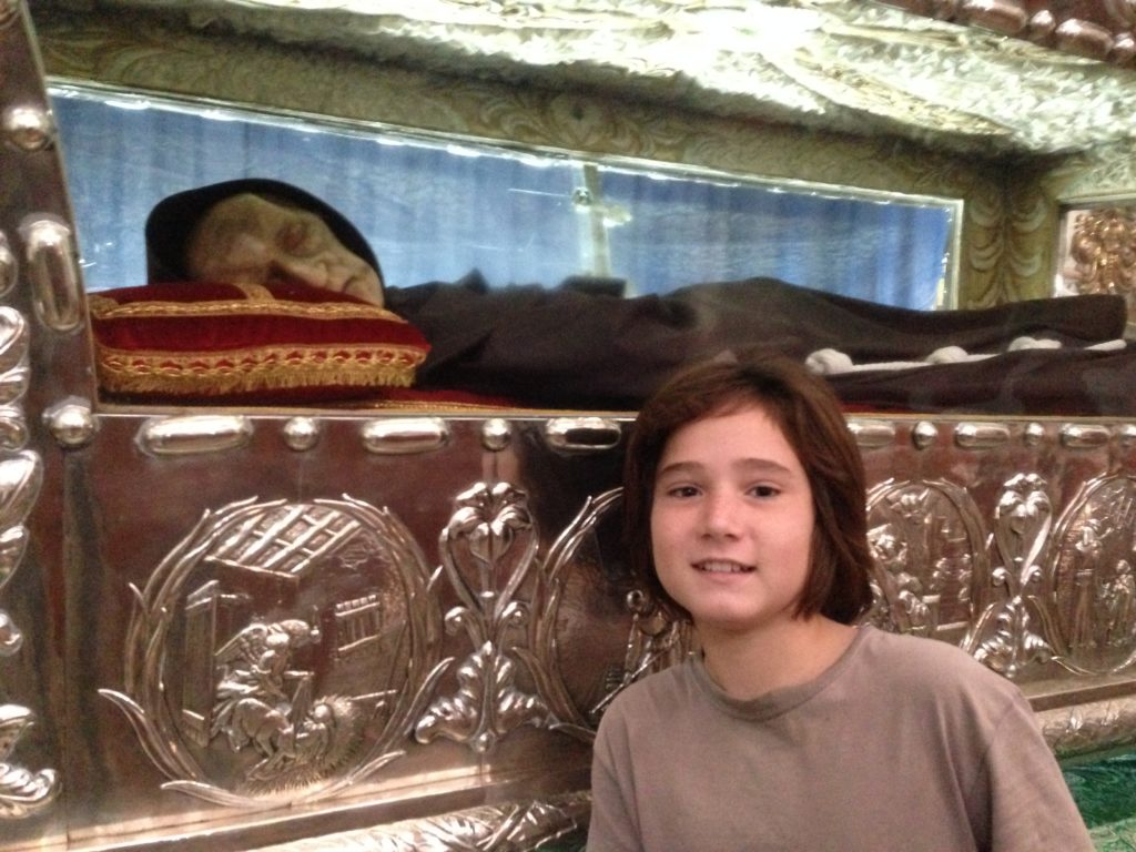 J poses with the mummified remains of Sebastian de Aparicio, the protector of conducirs.