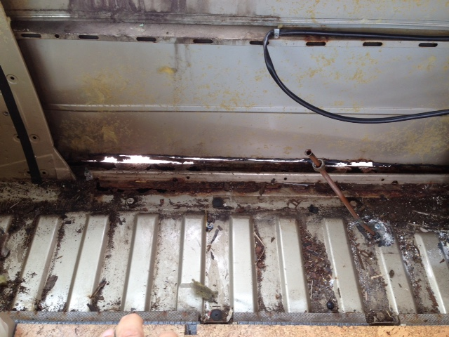 The main reason we needed to take out the cabinets is so that this rusty panel could be replaced.