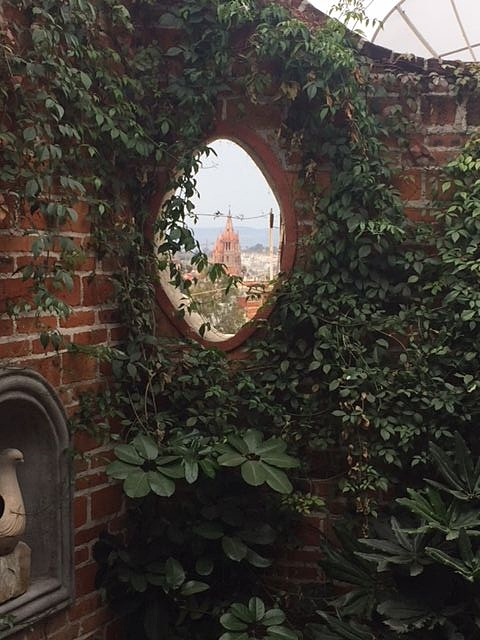 This window in our courtyard wall mirrors and lines up with the porthole window in J's bedroom for a keyhole view of the iconic Parroquia main church of San Miguel de Allende.