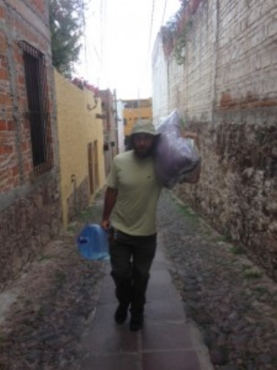 Here I am carrying our laundry and water up the alley and to the house. I had two bottles of family size Corona's in my back pockets.