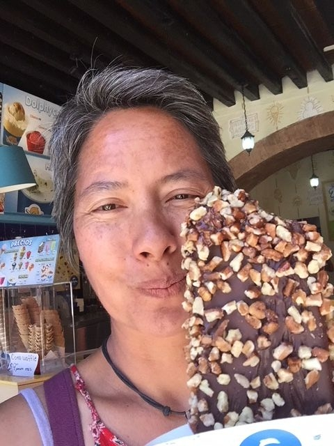 R, living the dream with a nut and chocolate covered ice cream bar.