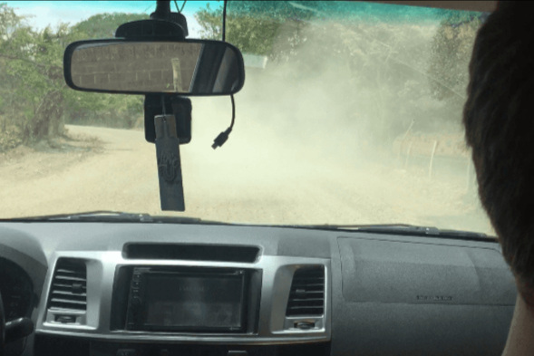 Can't even see the car in front of us through the dust