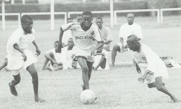 Yaya Toure (centre) playing youth football in the Ivory Coast