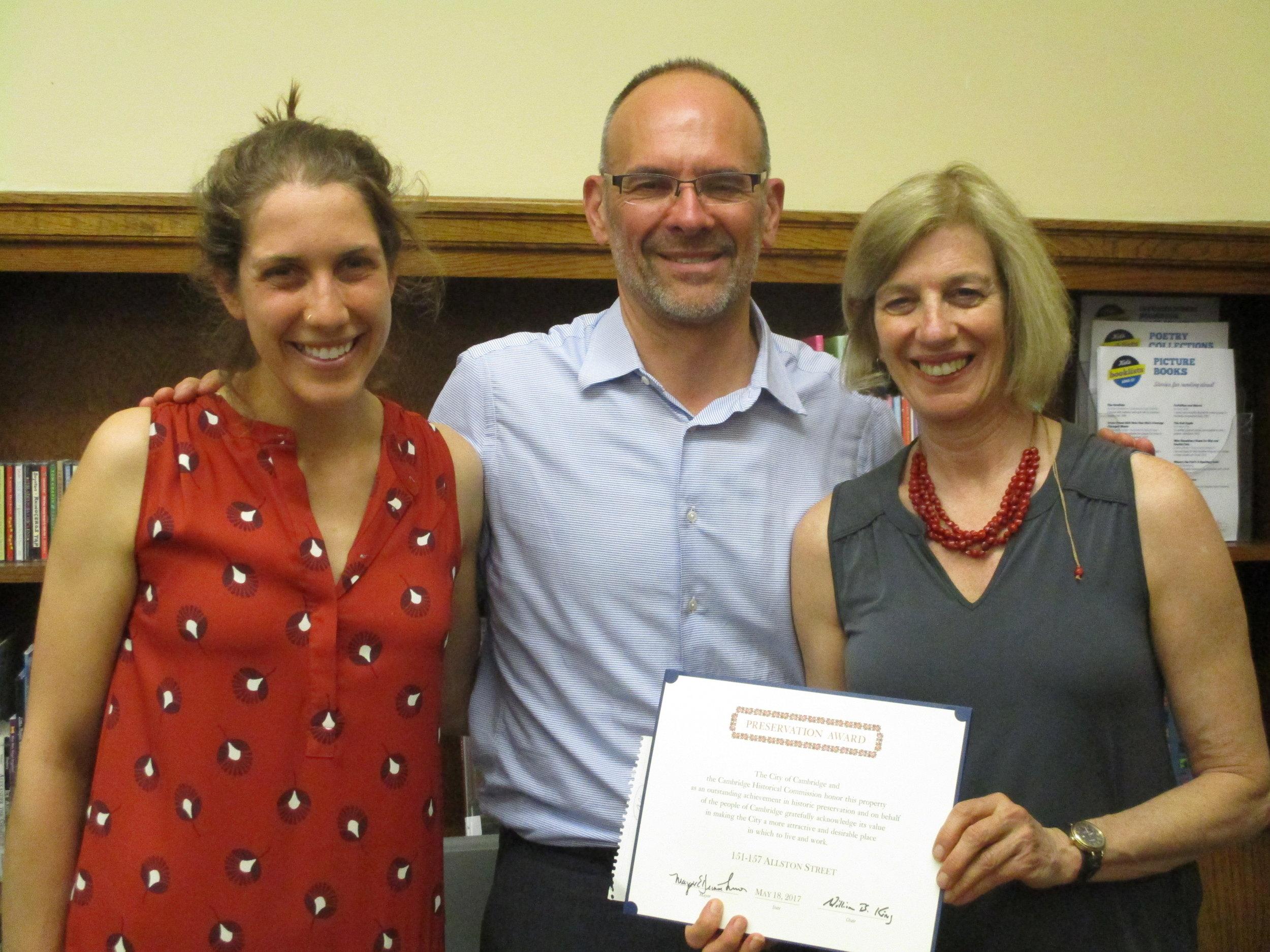 Rebecca Schofield (HRI), David Flaschenriem (TNG), and Jane Carbone (HRI) accept the Preservation Award for 151-157 Allston Street.