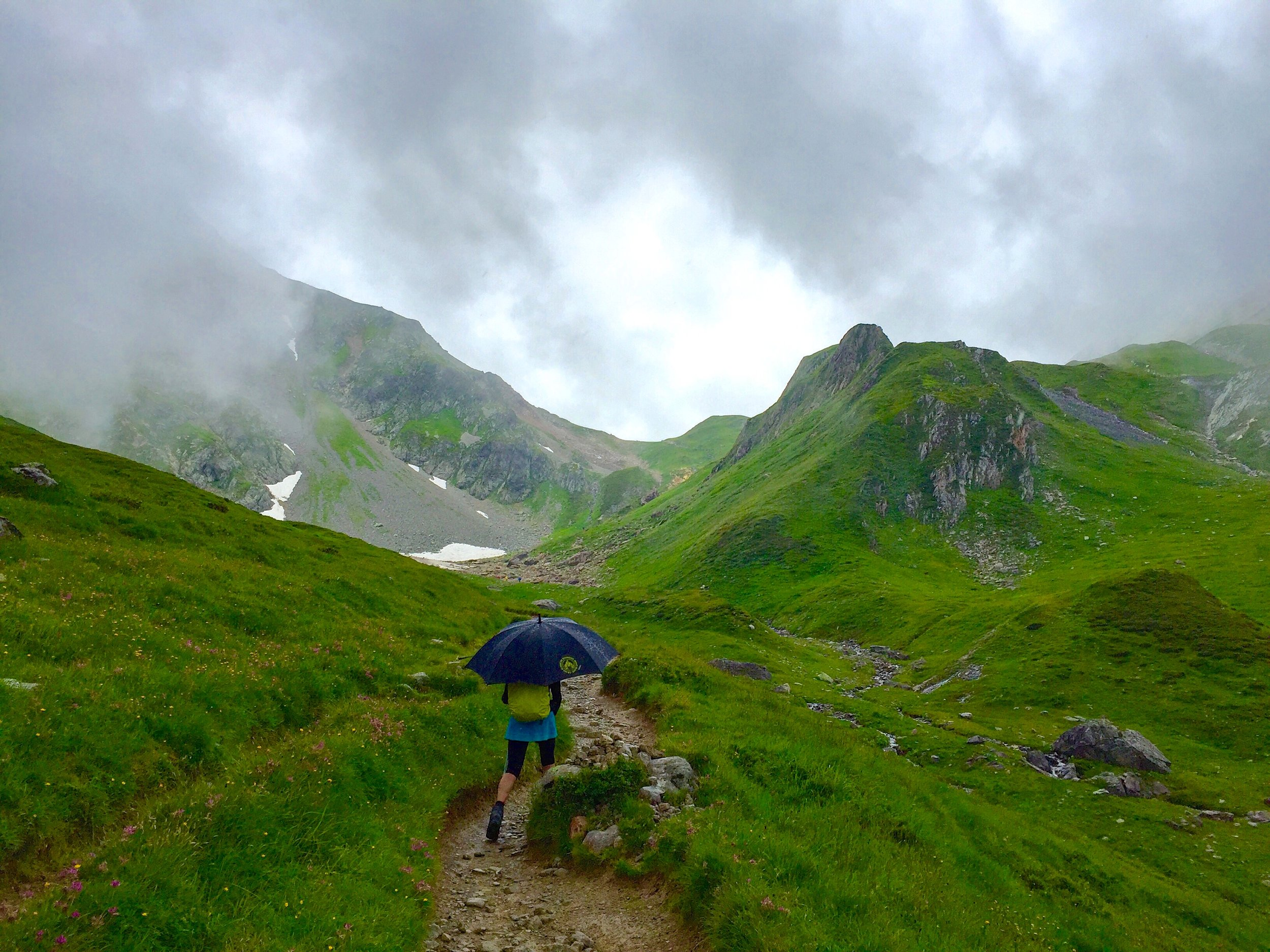 Our guide, Flo, hiking with an umbrella in the rain. I had never seen a guide hike with an umbrella before. But the French have a certain savoir faire, non?