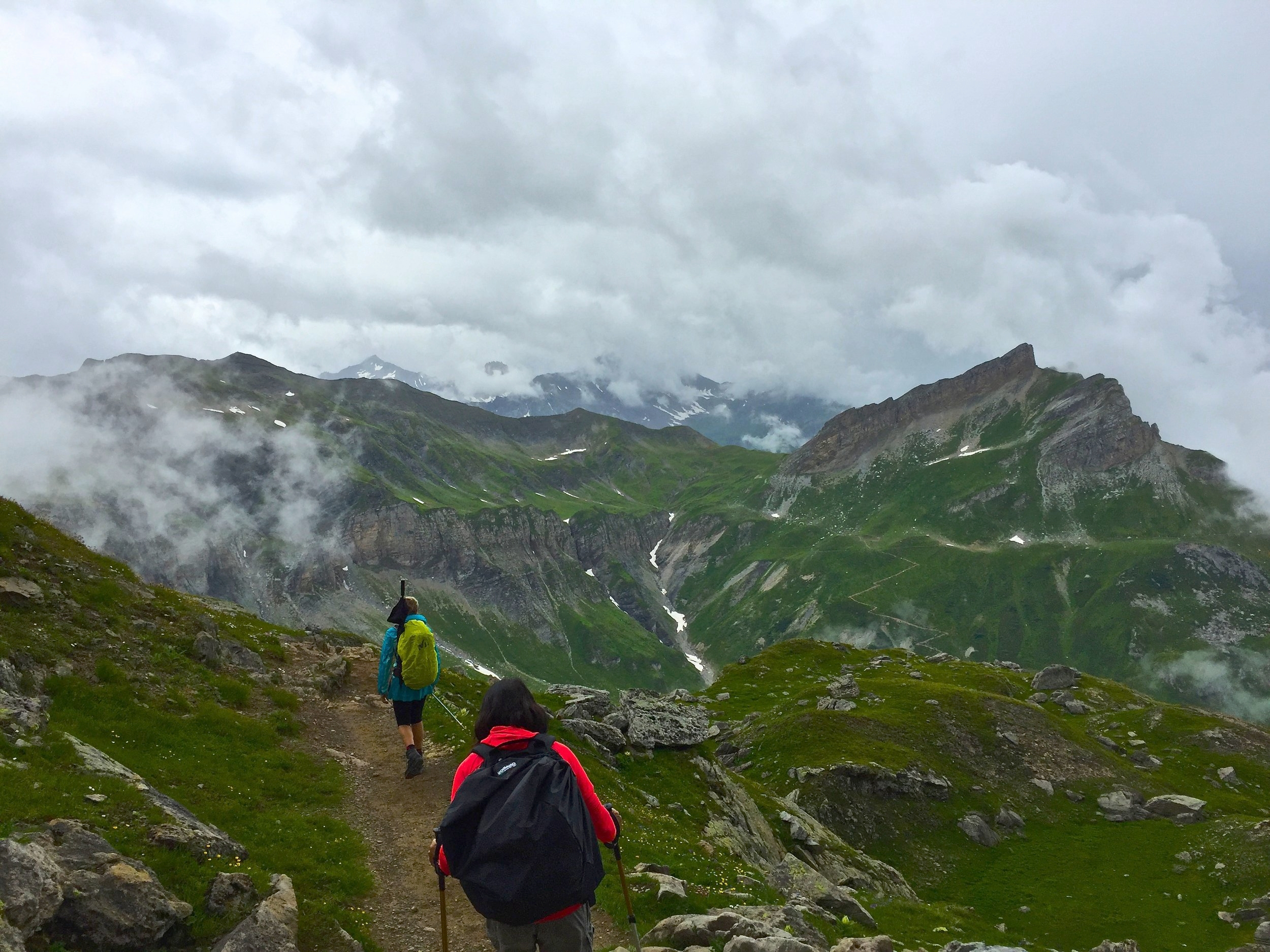 Hiking past Col du Bonhomme we find ourselves in and above the clouds.