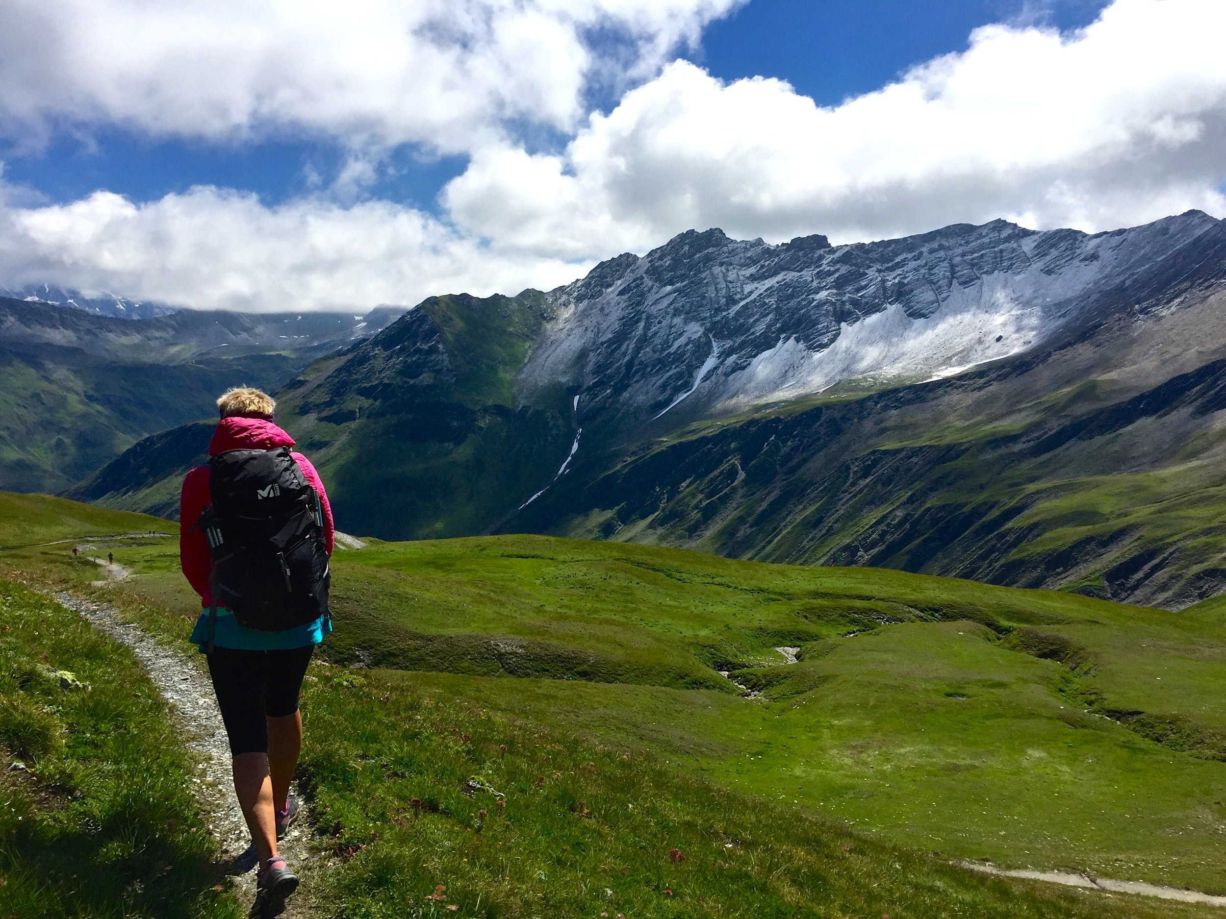 Hiking down into Switzerland, one of three countries you'll trek through on the Tour du Mont Blanc.