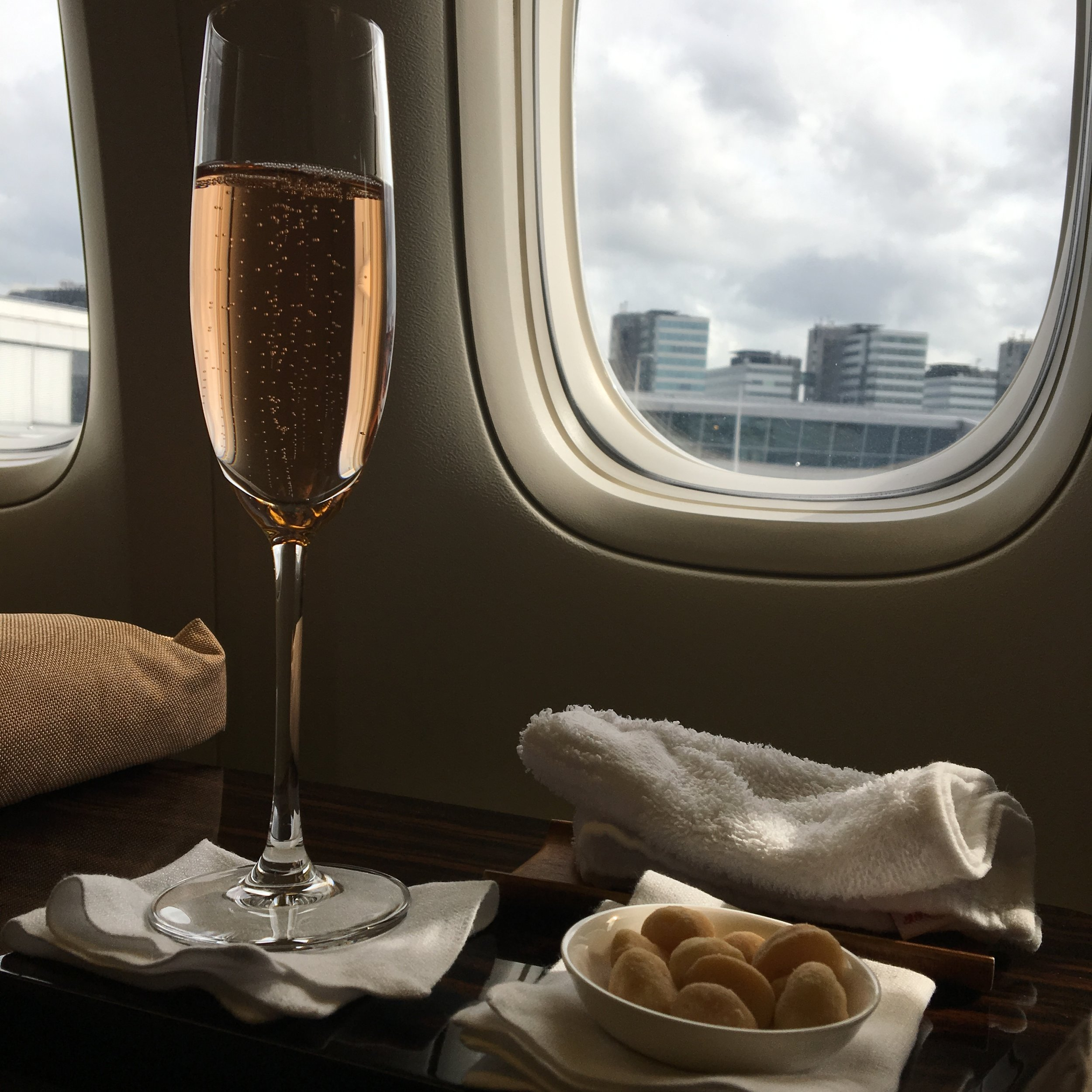 Hot towel service, a nice glass of Billecart - Salmon Brut Rose, and warm macadamia nuts is an excellent way to start a flight.