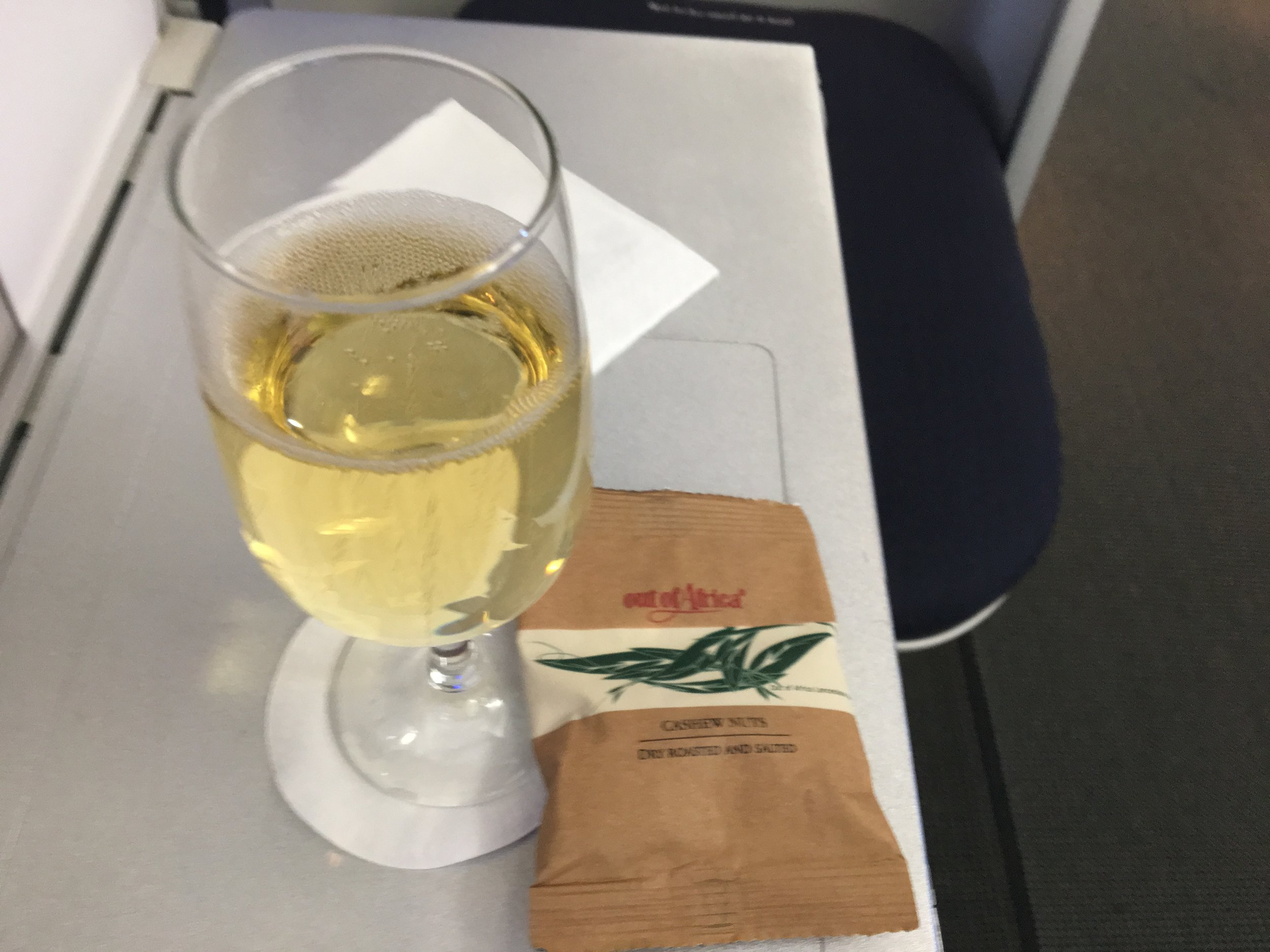 Celebrating my upgrade with a little champagne and a snack on the upper deck of this British Airways 747.