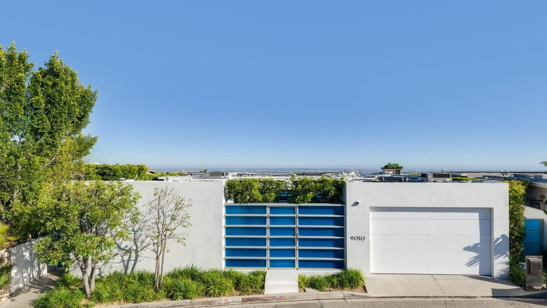 The slick modern home is located in the exclusive 'Bird Streets' neighbourhood above Sunset Strip in Hollywood Hills.