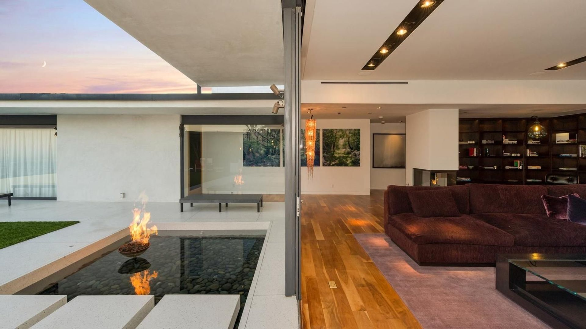 A perfect home for entertaining, the enormous open plan living space features walls of glass opening to the outdoor entertainment area with fire pits.