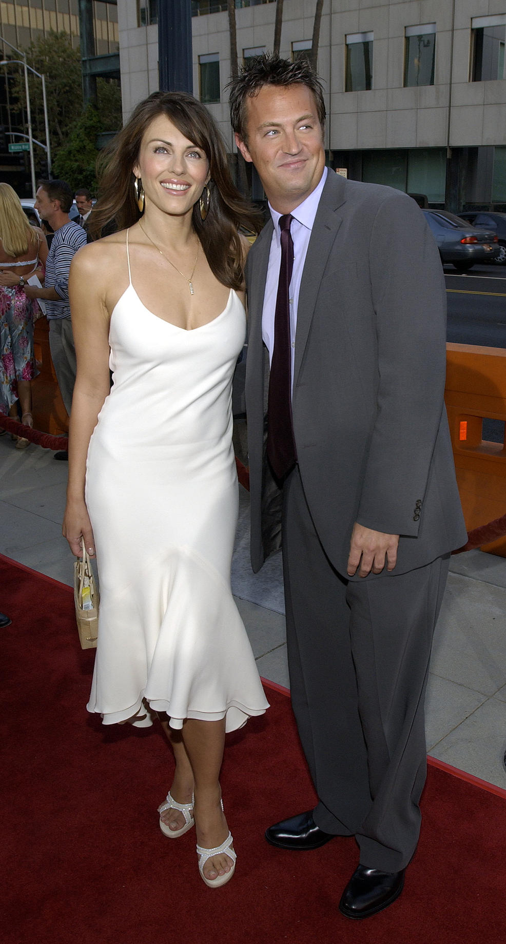 Getty Images. Elizabeth Hurley and Matthew Perry.