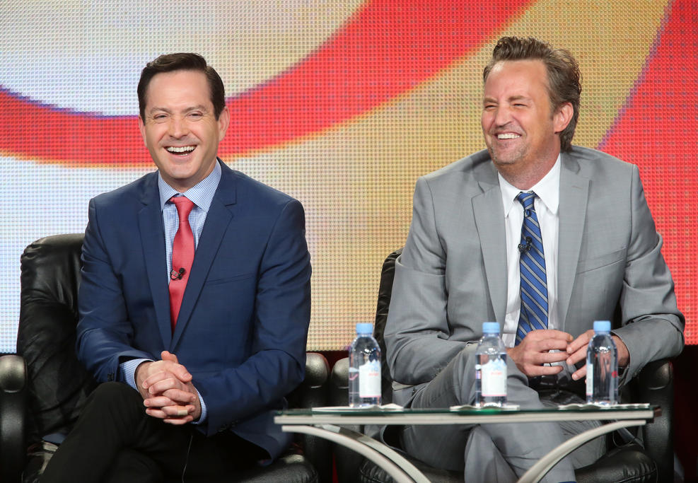 """Getty Images. Actor Thomas Lennon (L) and actor/executive producer Matthew Perry speak onstage during """"The Odd Couple"""" panel as part of the CBS/Showtime 2015 Winter Television Critics Association press tour at the Langham Huntington Hotel & Spa on January 12, 2015 in Pasadena, California."""