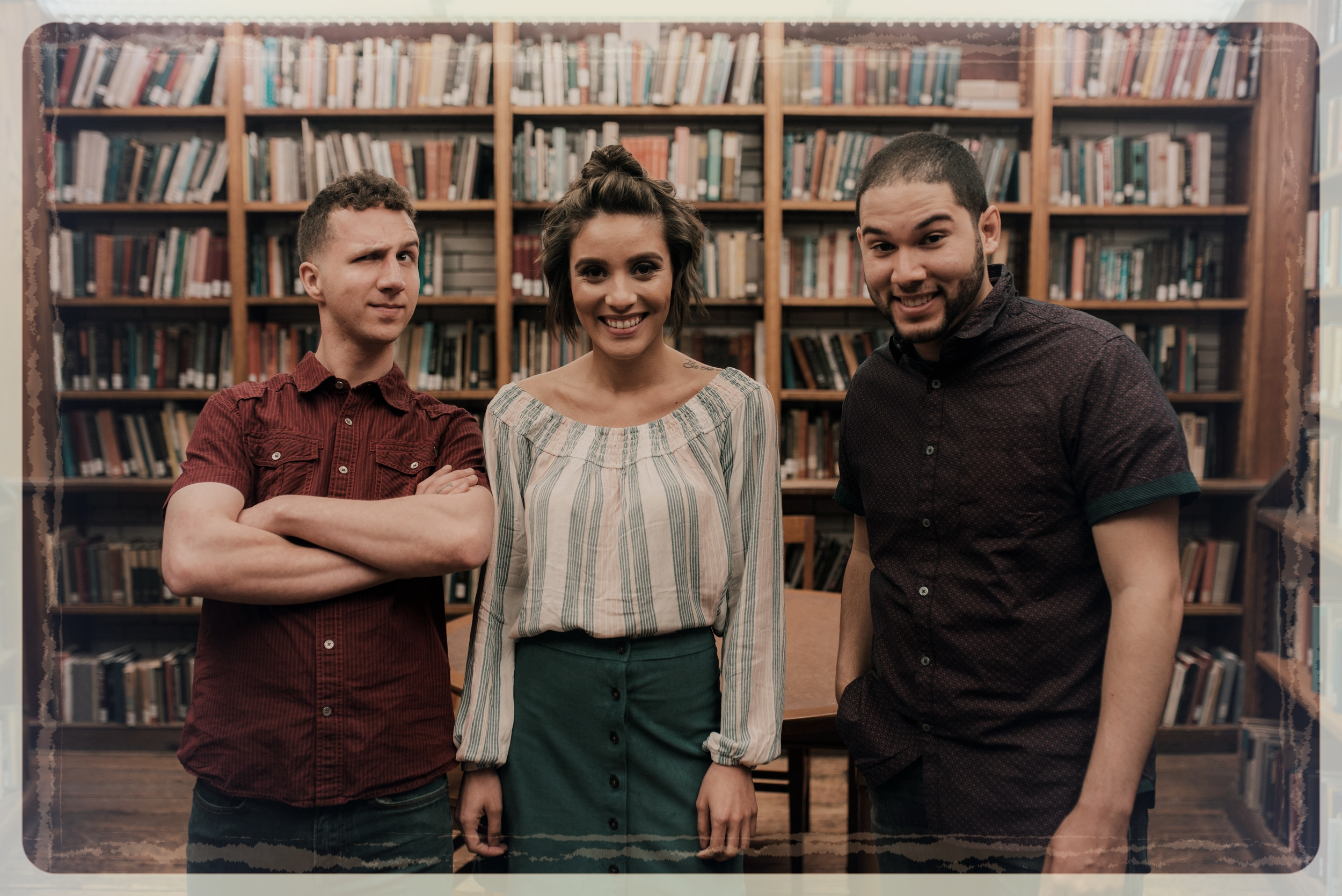 Dave, Brianna, and Christian goofin' around on set during the scene in the library.