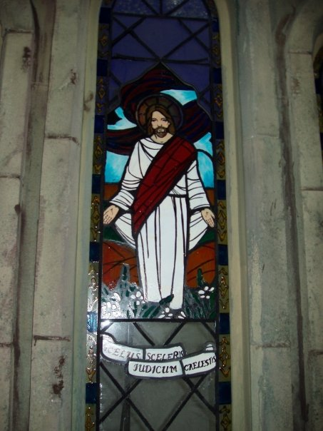 """I made this """"stained glass"""" window for a post-apocalyptic Church set from plexiglass, lots of glue, food dye, permanent marker, and plastic tubing."""