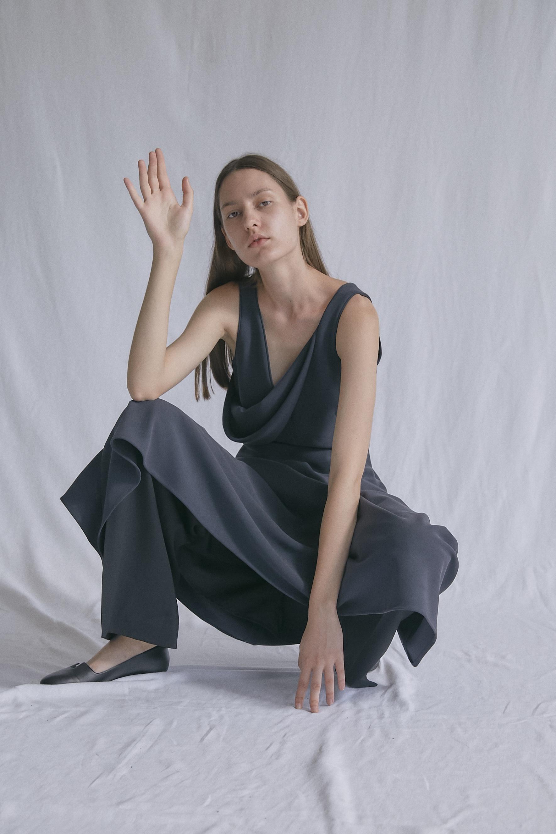 AI   asymmetric drape dress worn with   IWAO   wide—leg trousers