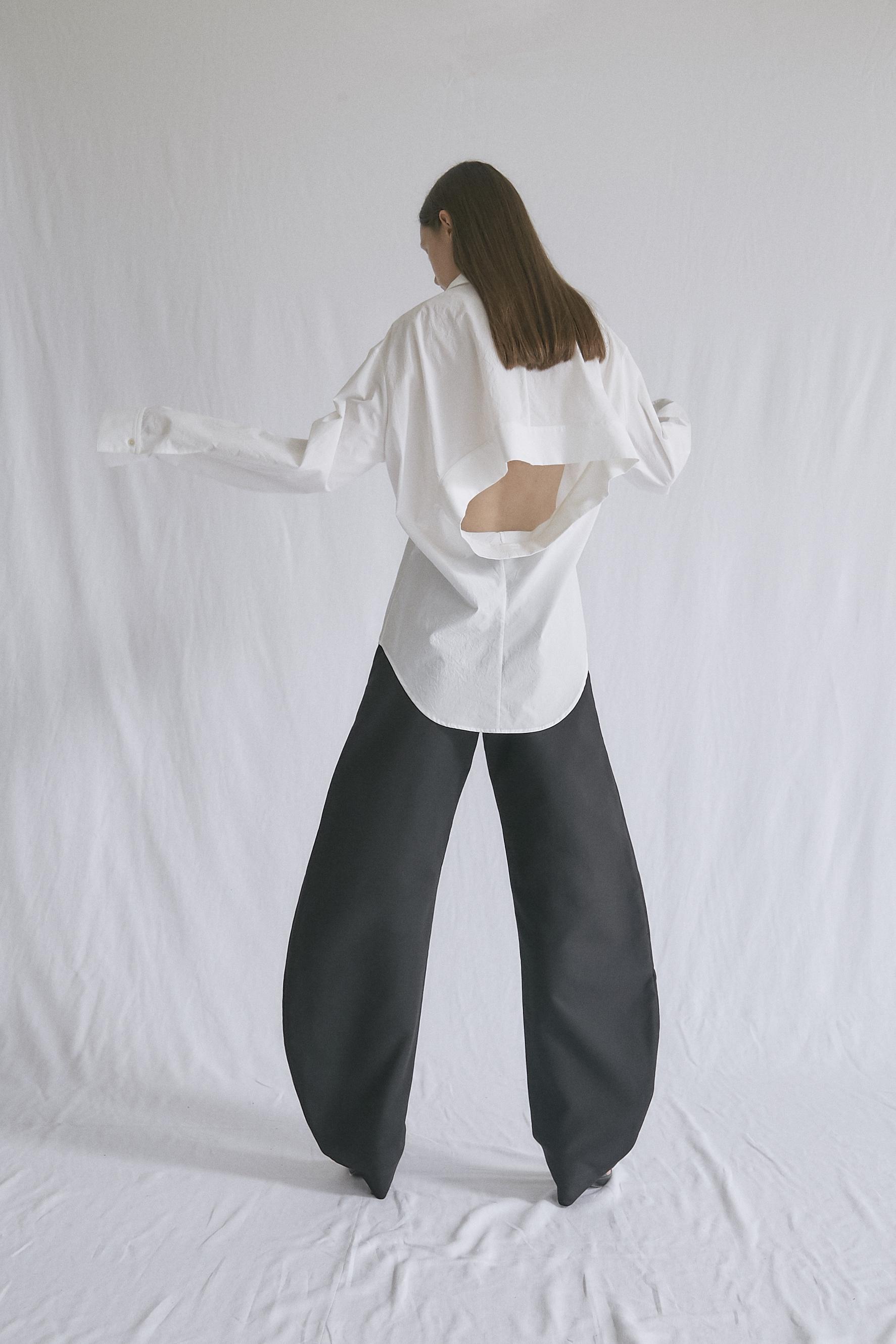 OSKAR   slash—back shirt and   BRANDT   round trousers