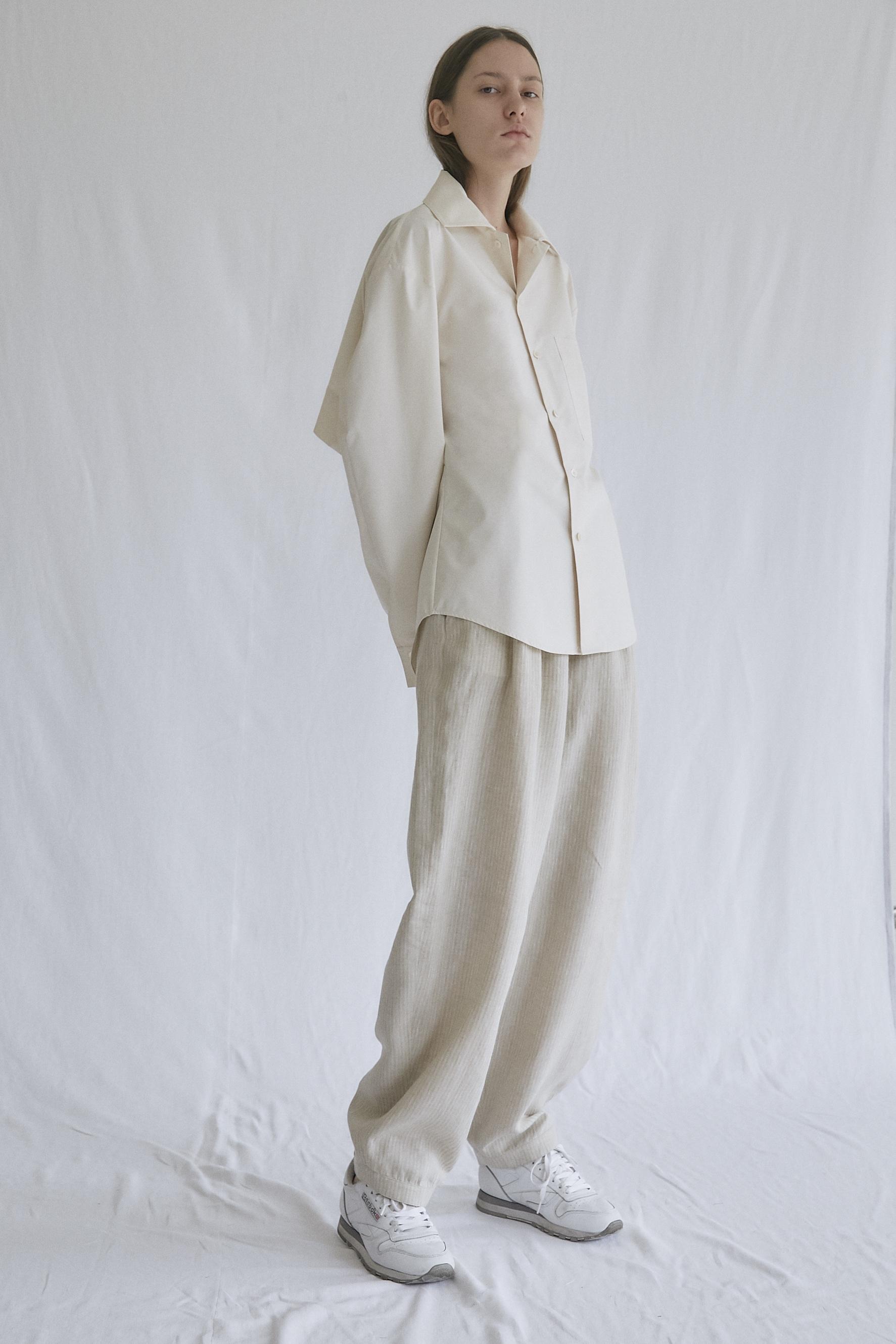 OSKAR   slash—back shirt in powder and   MIRO   gathered—waist trousers