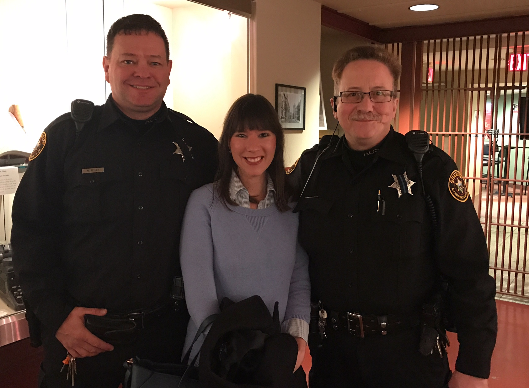 Jo Ana Vaz, Founder PIT Shop, with officers from the Allegheny County Sheriff's Office.
