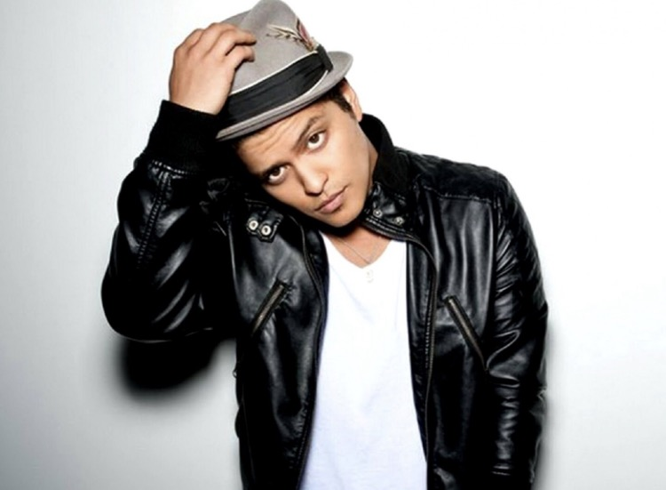 Bruno Mars  is actually not named after any planets...his real name is Peter Gene Hernandez.  Bruno Mars  was inspired by a nickname his dad gave him as a child. He teased him and called him Bruno after a chubby wrestler because he was a chubby kid. Mars came later because girls would say you're from out of this world!