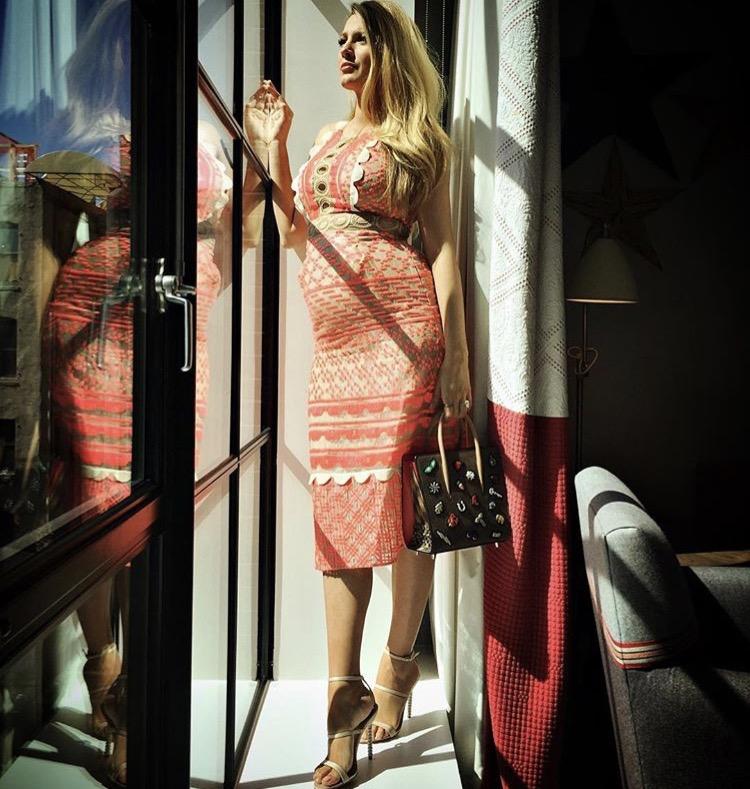 Dress: @jonathansimkhai • Shoes: @sophiawebster • Purse: @louboutinworld