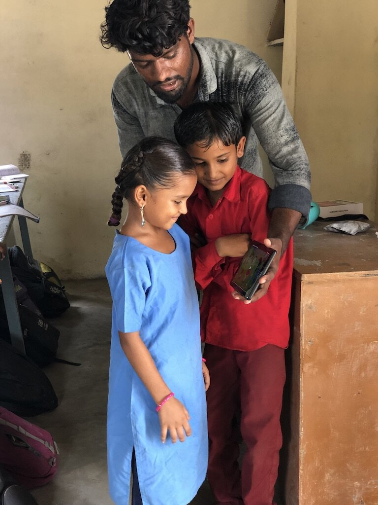 Karim with 2 young students