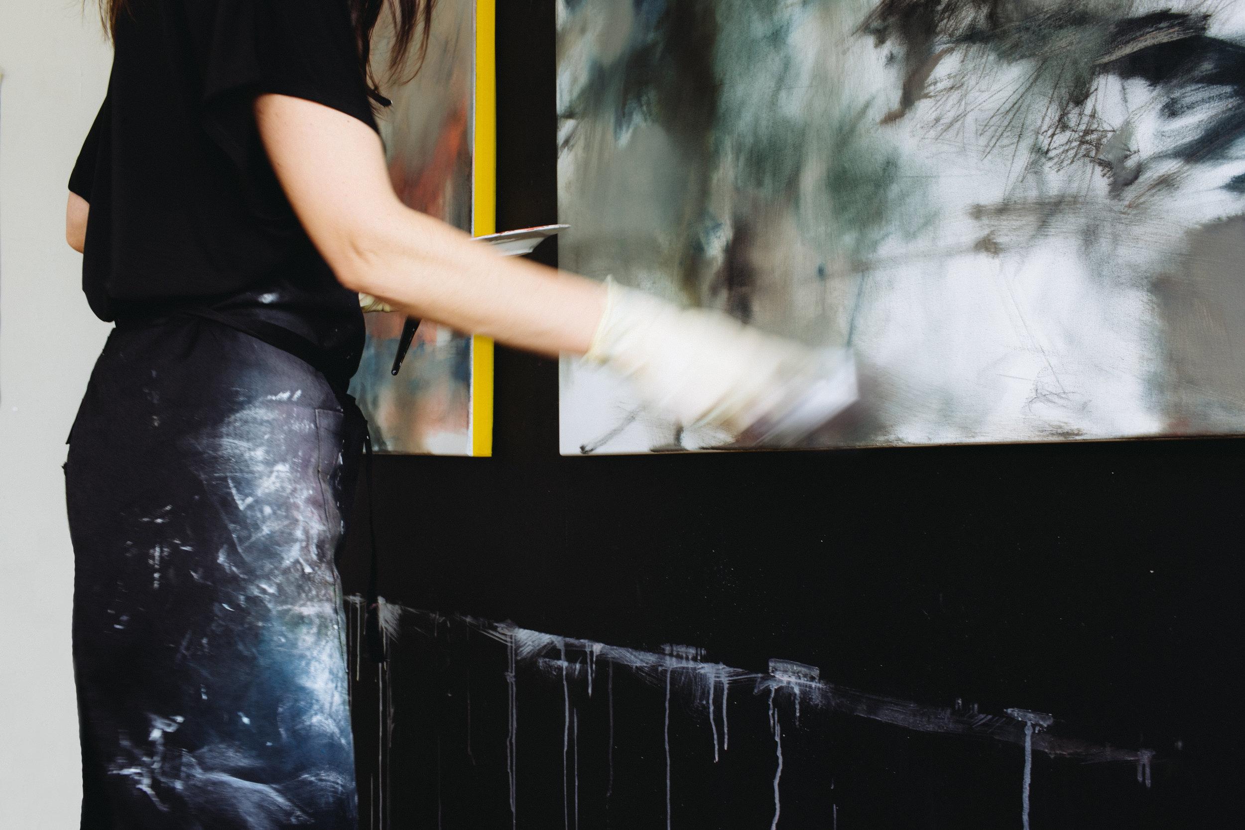 Amanda Watson painting in the studio