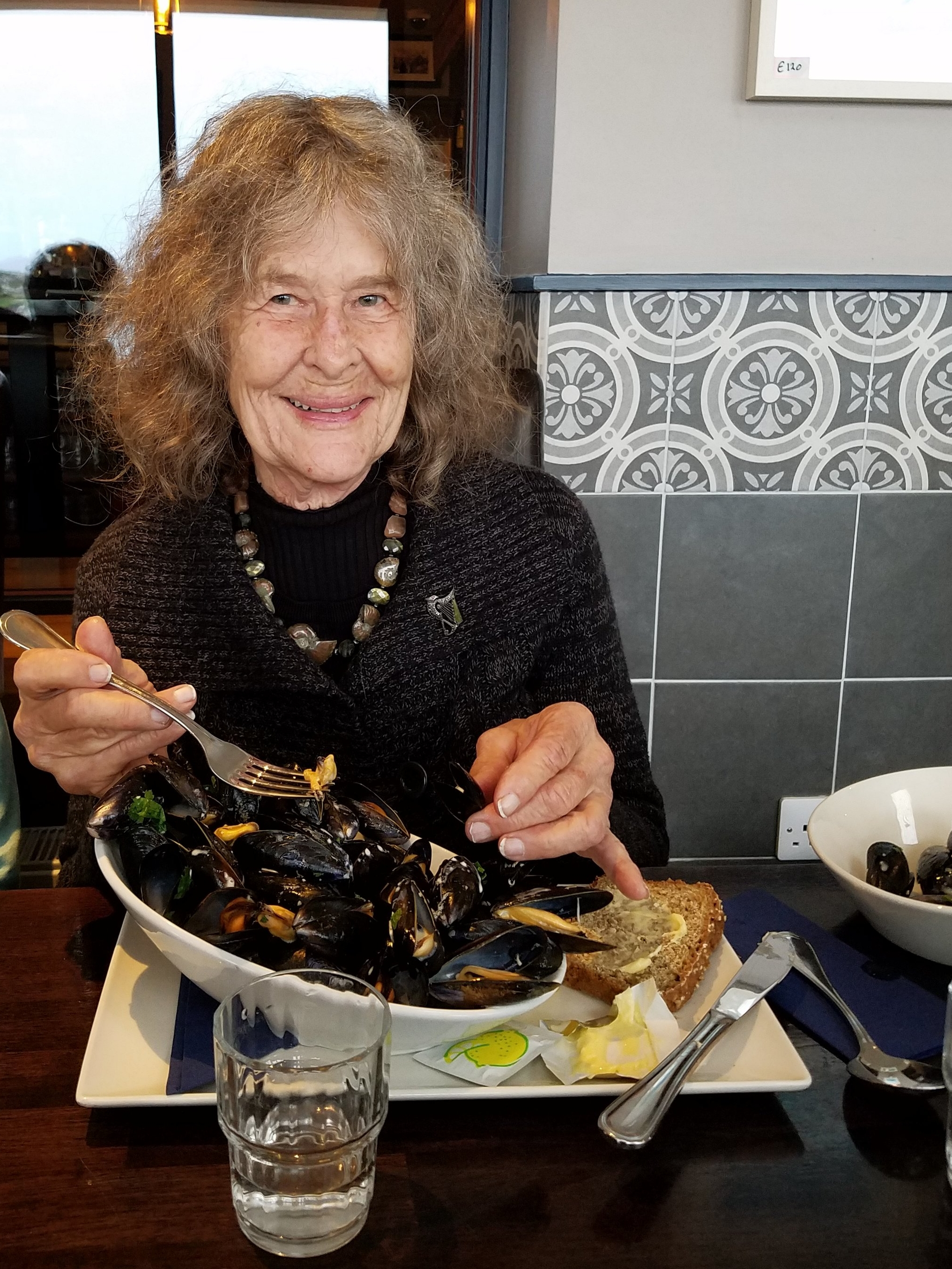 June enjoys the mussels at o'carroll's cove.