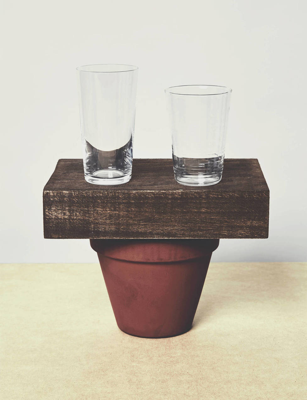 """There is an almost   emphatic sense   of   reason and rationality   to the object arrangement,"" notes Koren of the meeting of two glasses, a wooden block, and a flower pot. The pictorial intensity is enough to sustain interest, he concludes, until ""you run up against the conceptual dead-end"" of the plain, non-descript nature of the objects themselves. Pictured:   Serax Beaker Drinking Glass  ,   Collected by The Line 5.3 oz Glass"