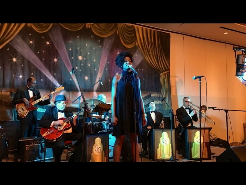 The George Gee Orchestra laying down a groove along with singer Shenel Johns
