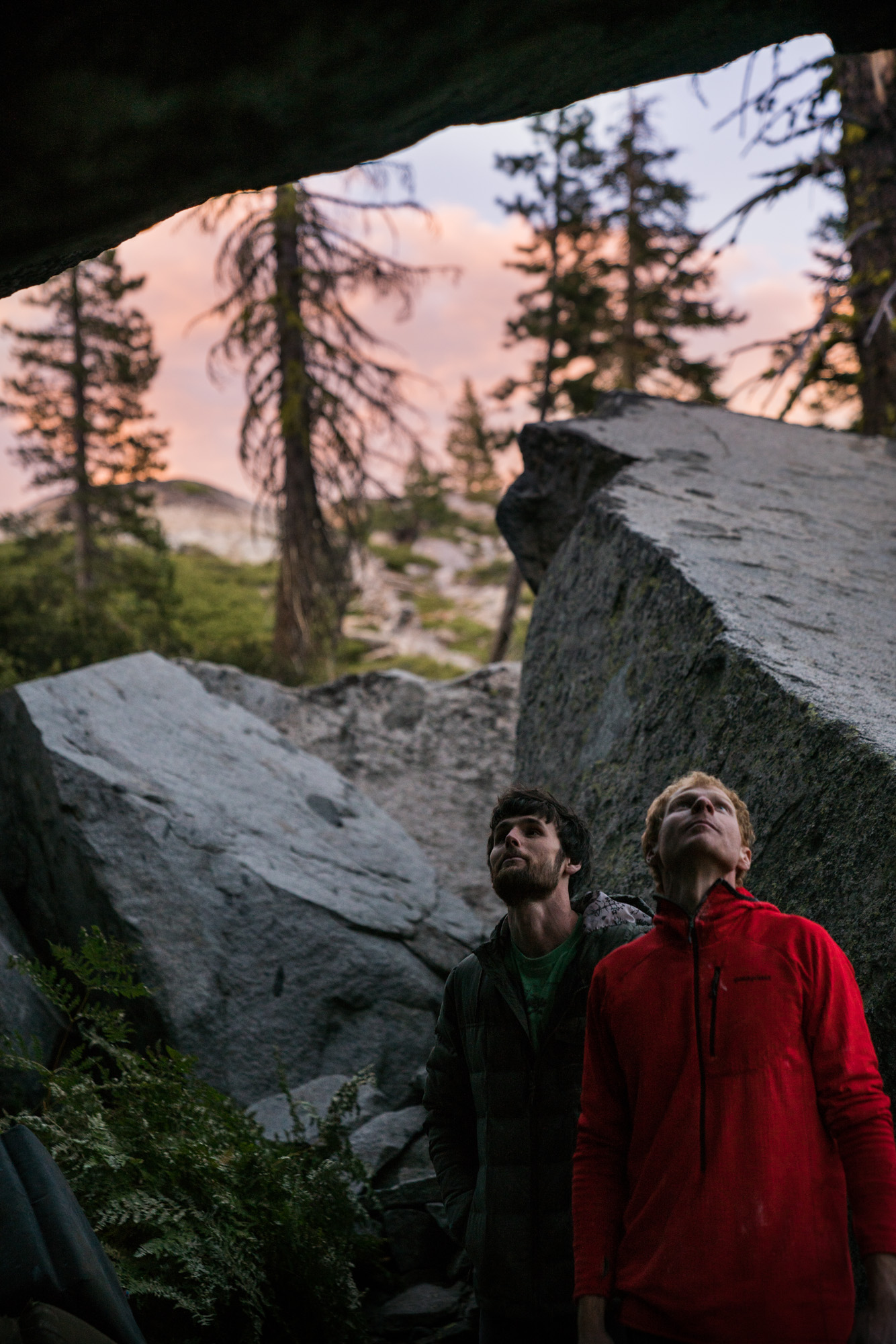 Just some bois in the woods, starin' at a boulder.