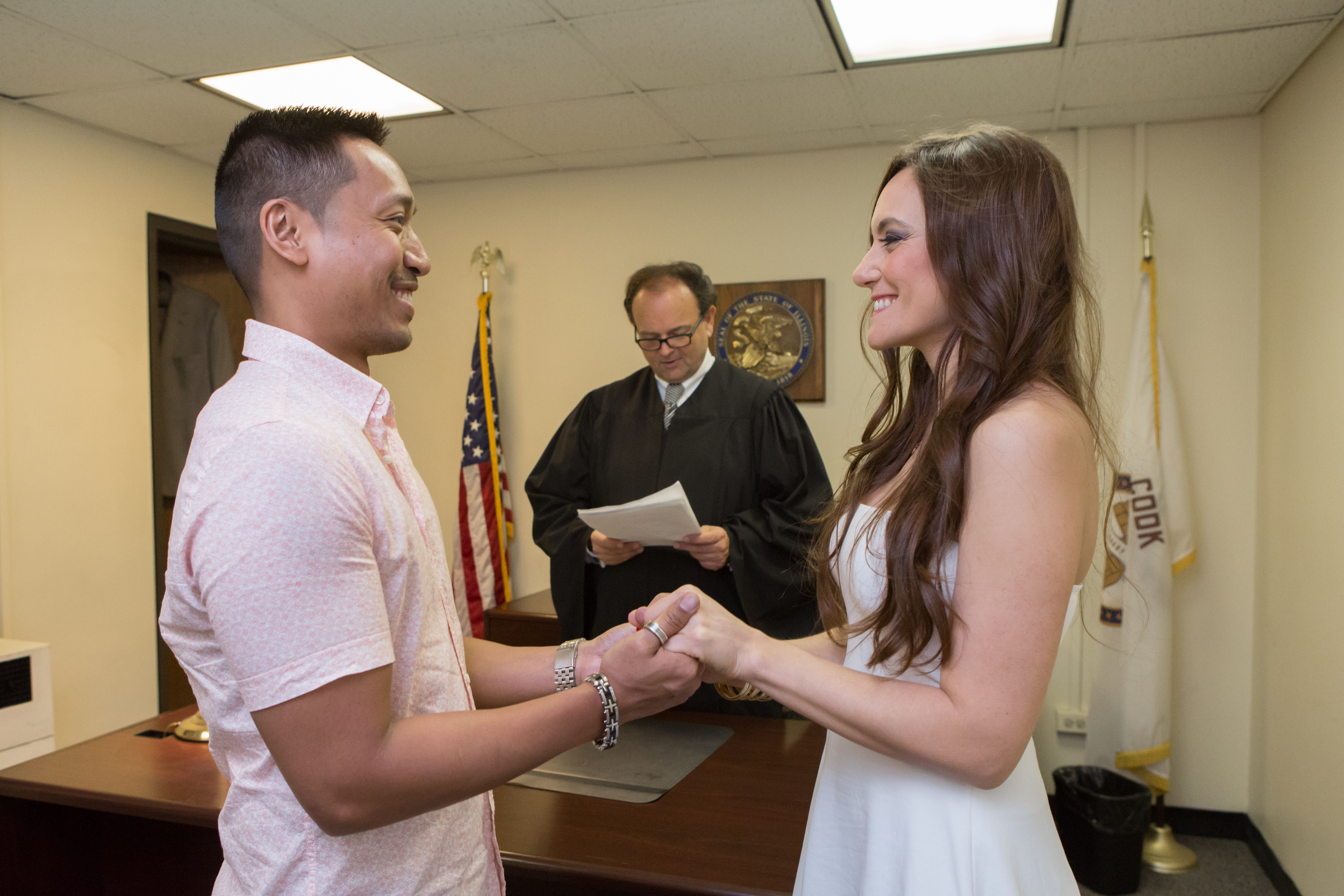 Aglade and Arnel getting married at the Chicago courthouse.
