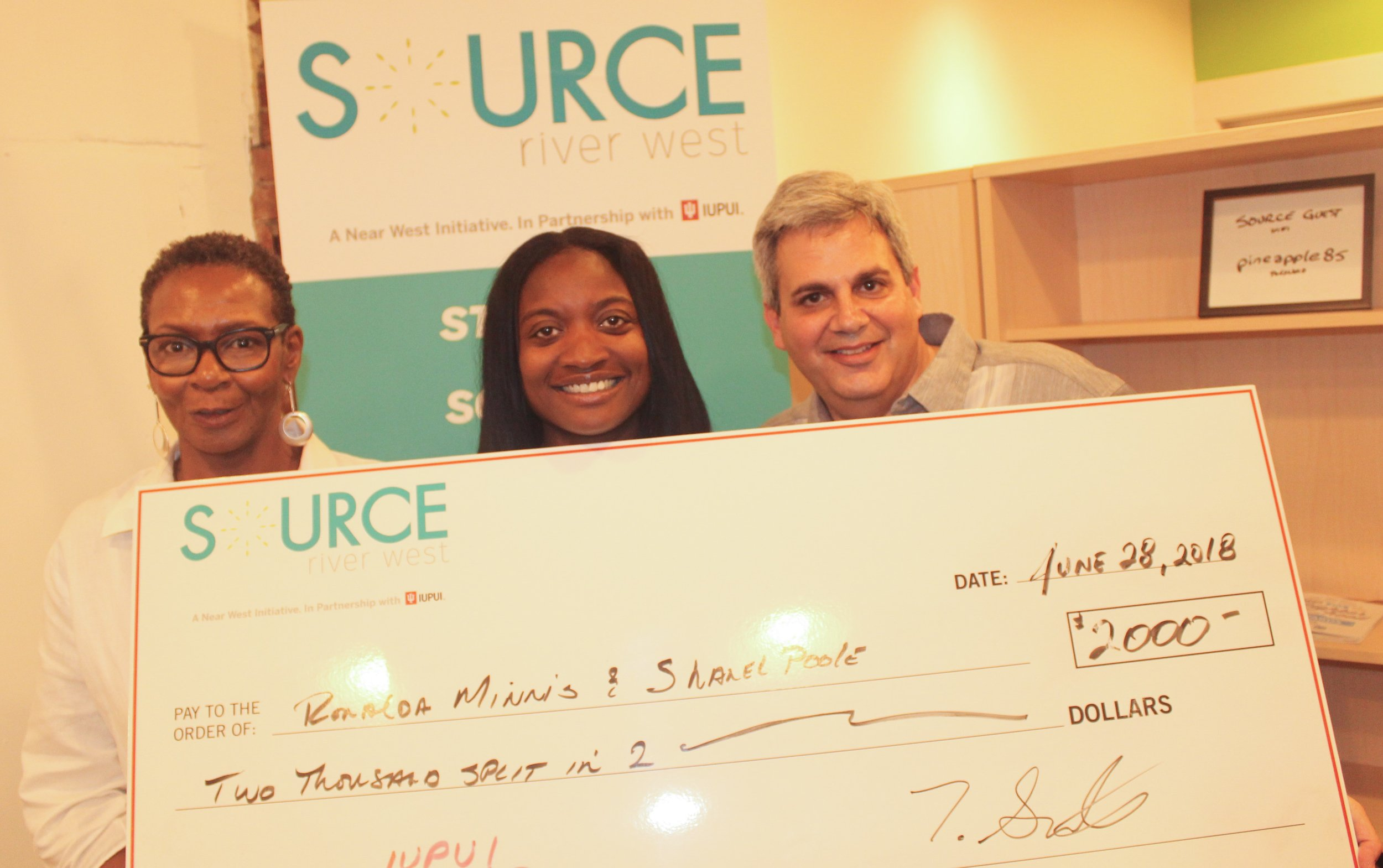 (From left to right) Ronalda Minnis and Shanel Poole with Mark Roger, Center Director at SOURCE RW