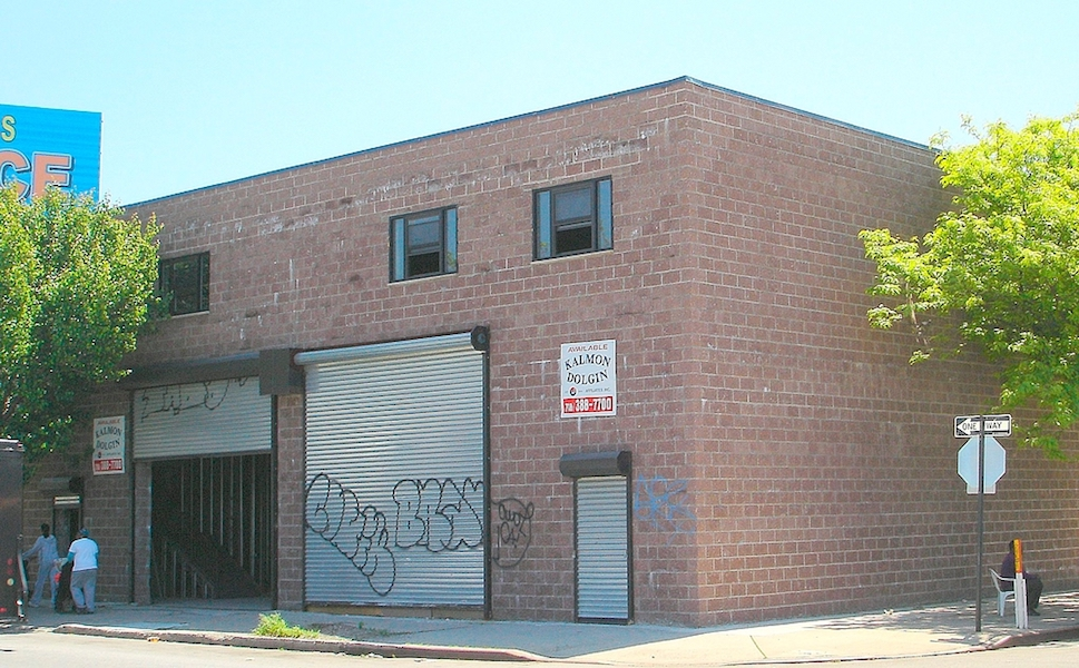 Before image of Changing Lives church before reconstruction brick building with graffiti