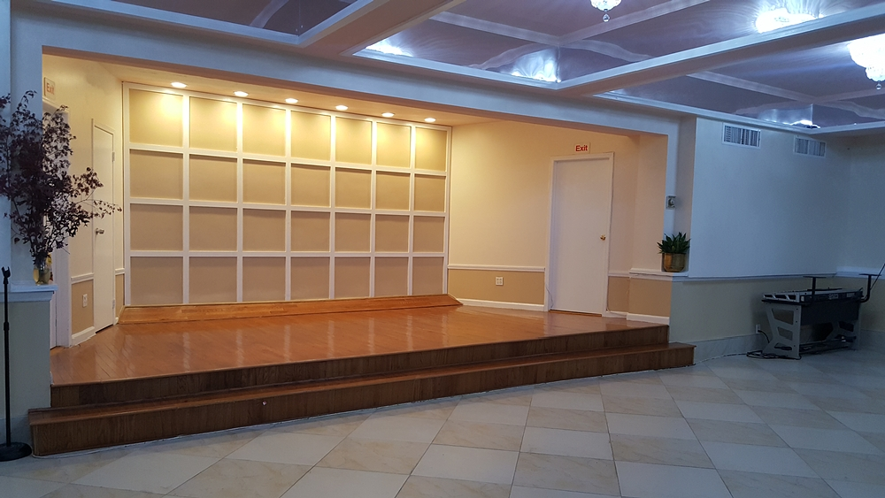 Interior of City Tabernacle church after completed construction with geometric grid for backsplash to podium