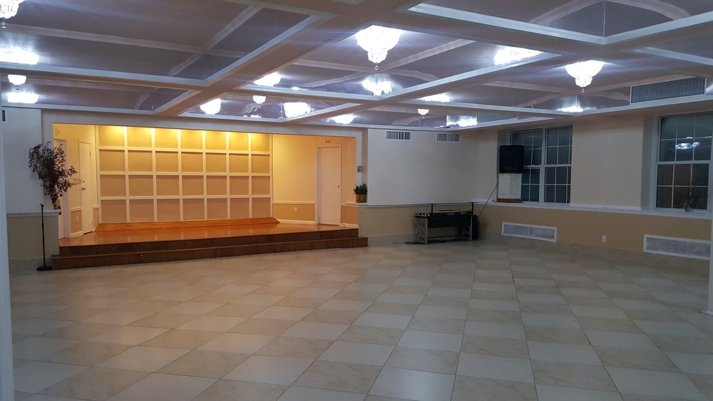 Interior of City Tabernacle church after completed construction with geometric grid for backsplash to podium from side view including overhead lights