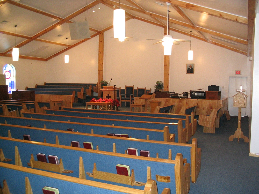 Interior of Emmanuel Baptist church after interior renovation with blue fabric lined pews
