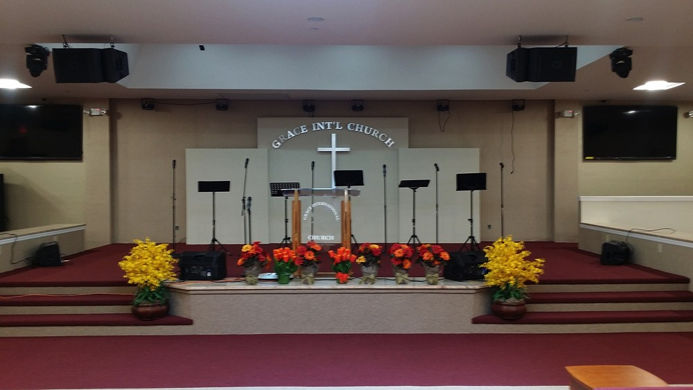 Completed interior of Grace International Church with fancy stage like podium