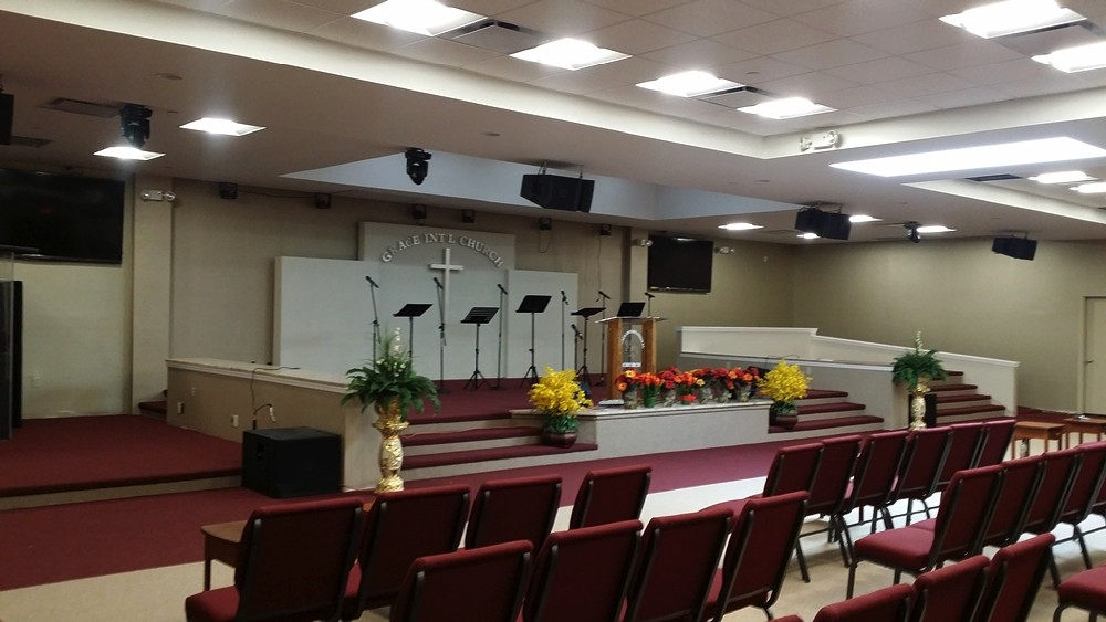 Side view of front rows of Grace International Church with view of altar and podium