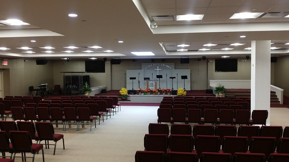 View from the back of Grace International Church with view of chairs and podium