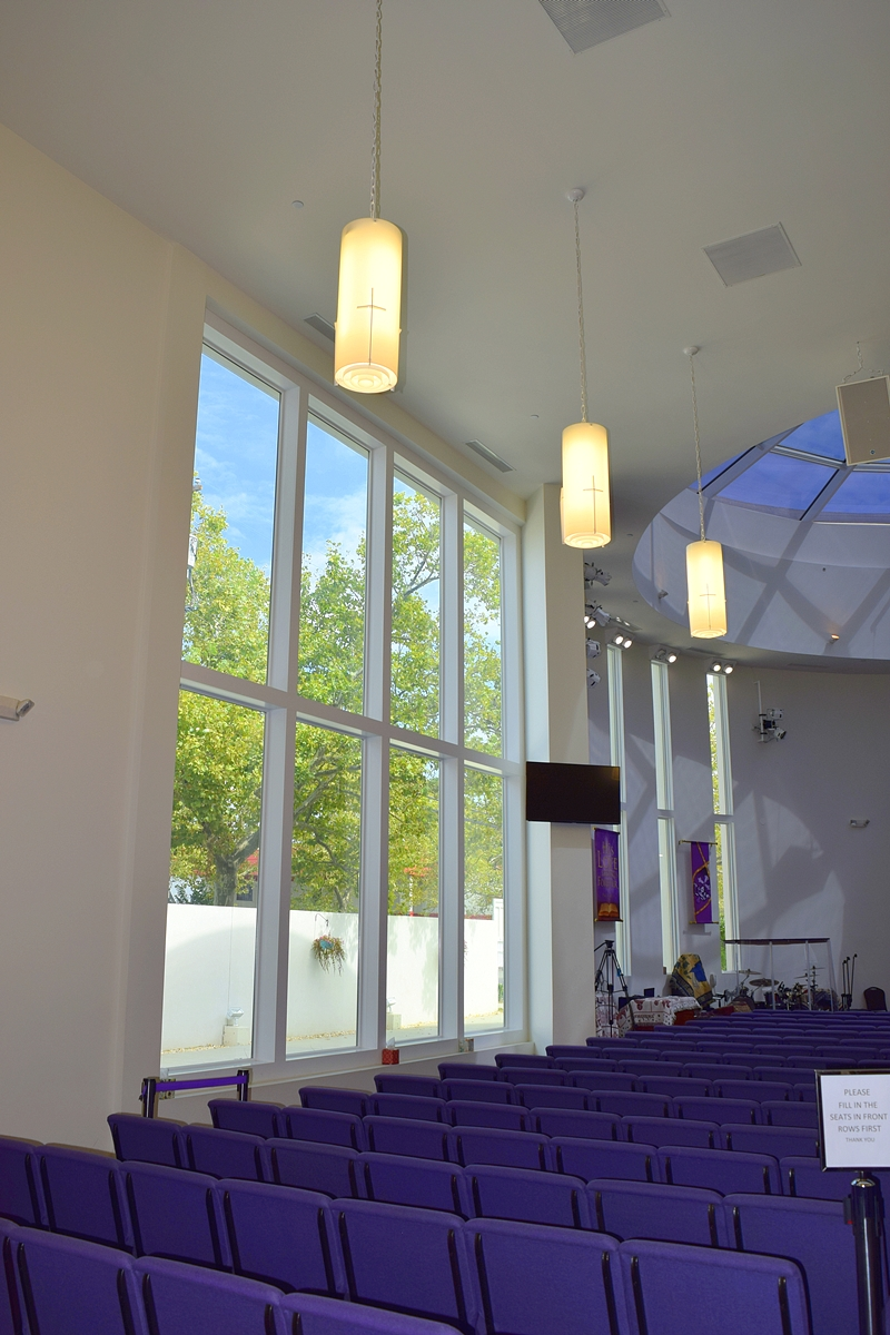 Tall windows next to seating area of Jerusalem Avenue Church of God of Christ