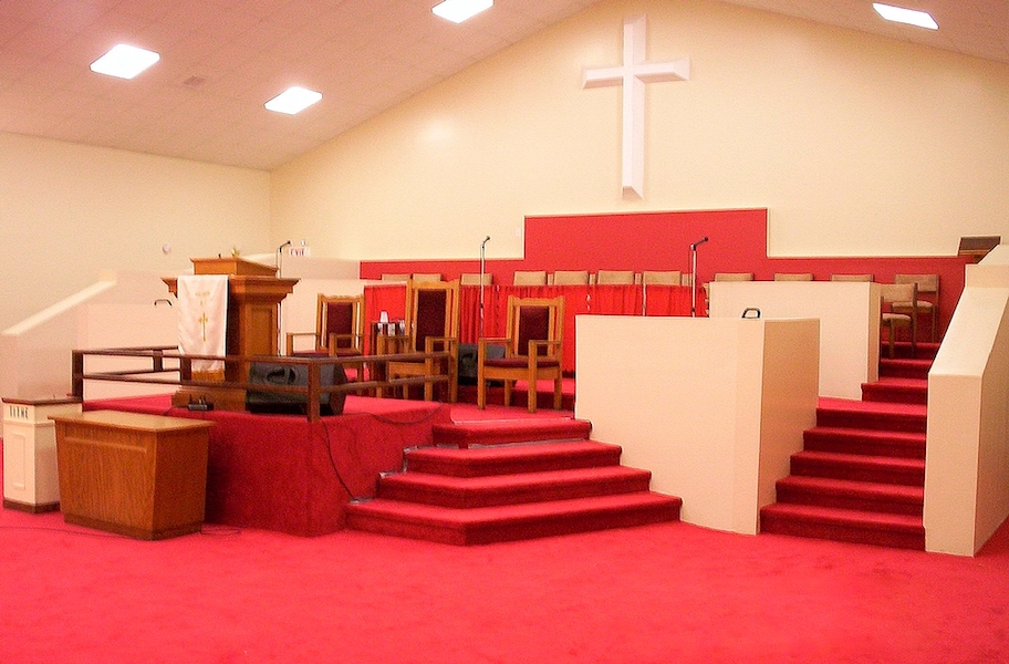 Completed Mt Sion Baptist Church podium and altar with red carpeted stage up front