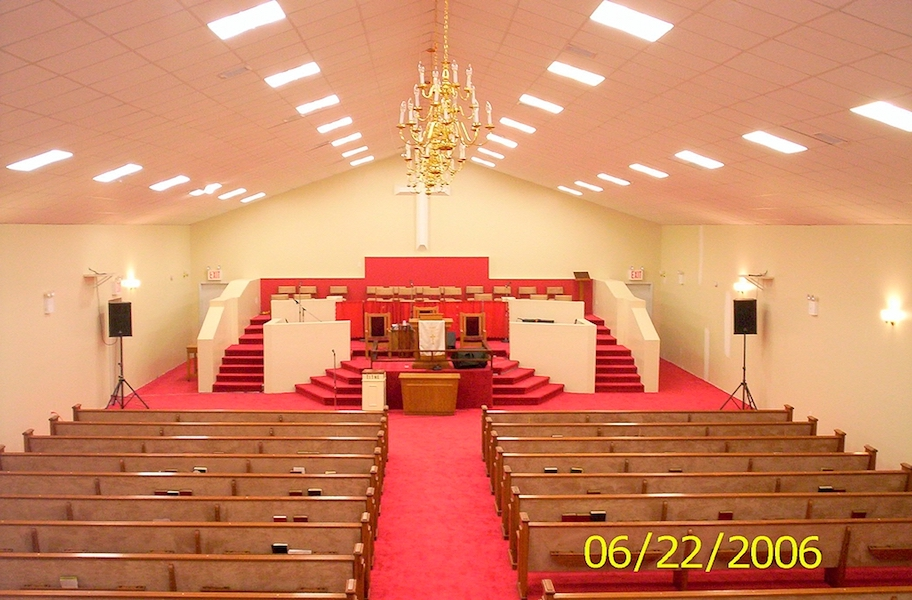 View of wooden church pews in Mt Sion Baptist Church