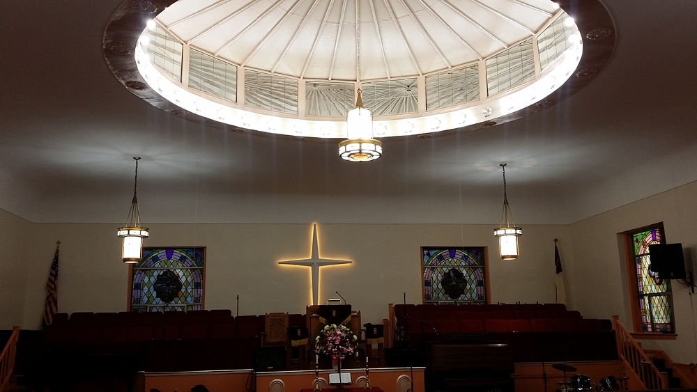 Choir and preaching space at St Johns Baptist Church with dome ceiling
