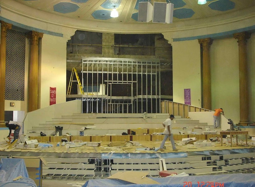 Triumphant COG church interior during construction and renovation of church
