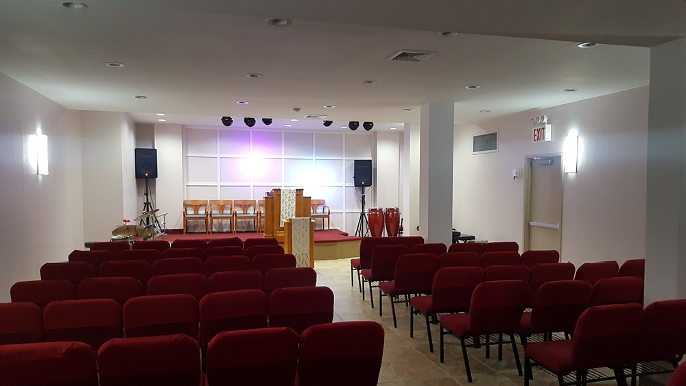 Interior view of Washington Avenue church looking up at podium and altar with grid backboard