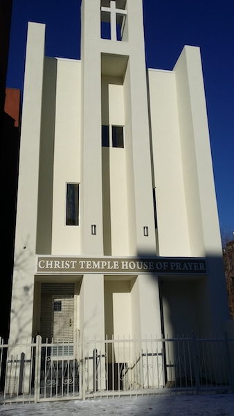 Exterior view of Christ Temple House of Prayer after completed construction with white steeple